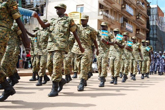 Uganda People's Defense Forces (UPDF) members marching along the streets of Kampala during the celebration of the East African Community Week on December 04, 2015. (Photo by /Godiver Asege)